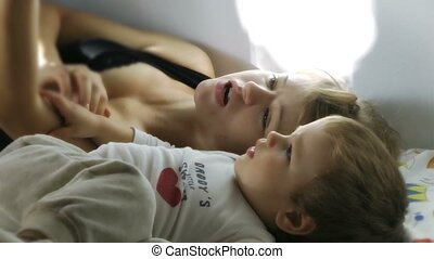 Mother and Boy reading Stories