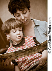 Mother and  boy together read the book