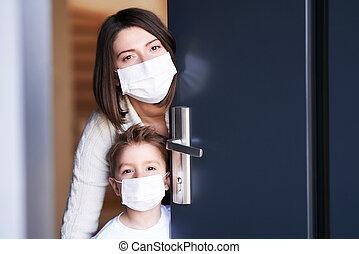 Mother and child at home quarantine during coronavirus pandemic
