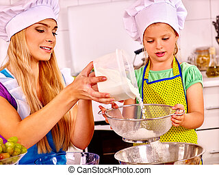 Mother and child baking cookies.