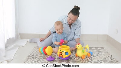 Mother and child boy play together indoors at home
