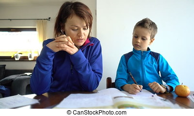 Mother and child doing school homework, 4K resolution