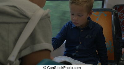 Mother and child exploring map in train