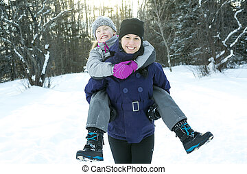 Mother and child girl on a winter in nature.