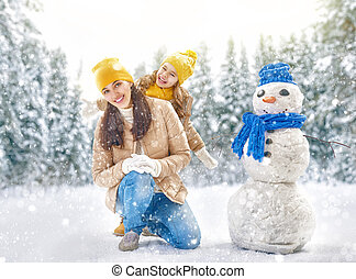mother and child girl on a winter walk in nature
