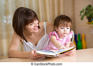mother and child girl reading a book
