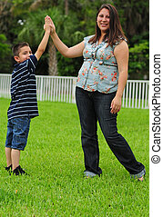 mother and child giving high five