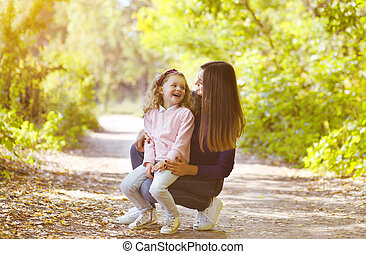 Mother and child having fun outdoors in park