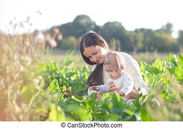 Mother and child in field