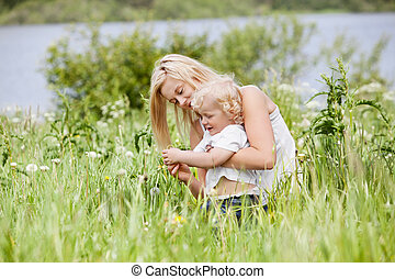 Mother and child in grass