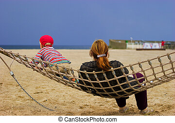 Mother and child in hammock