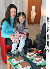 Mother and child looking at a building model