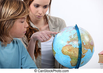 Mother and child looking at a globe
