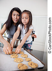 Mother and child making cookies