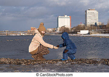 Mother and child on a river bank