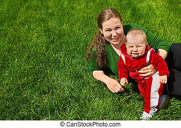 Mother and child on grass