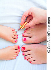 Mother and child paint their feet with nail polish - Young ...