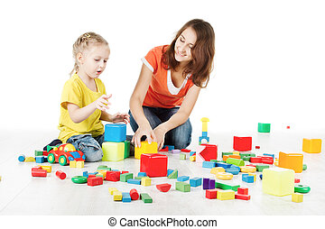 Mother and child playing blocks over white