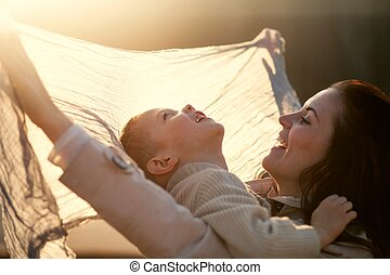 Mother and child playing in park outdoor