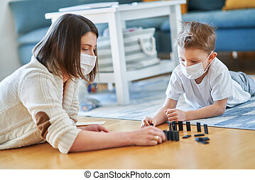 Mother and child playing together at home isolation during coronavirus pandemic