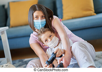Mother and child playing together at home isolation duringcoronavirus pandemic