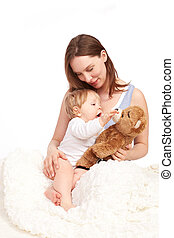 Mother and child playing with teddy