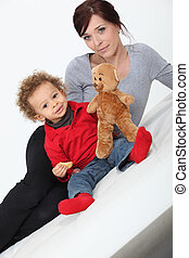 Mother and child posing with a teddy bear