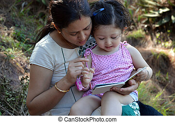 Mother and child read a book