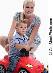Mother and Child riding toy car