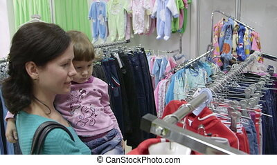 Mother and child shopping in clothes shop