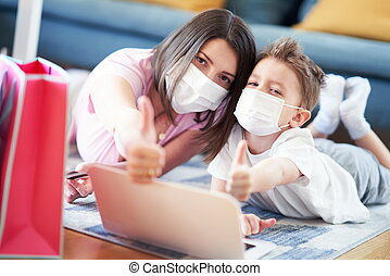 Mother and child shopping online during coronavirus pandemic