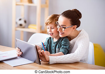 Mother and child using a tablet - Click on it. Young...