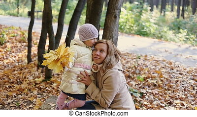 Mother and child walking in park