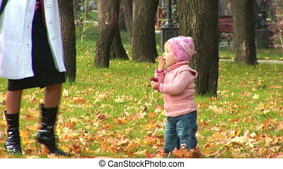 Mother and child walking in the park
