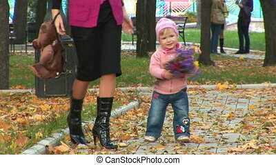 Mother and child walking in the park - High definition video