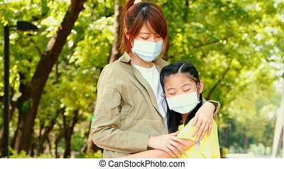 mother and child wear face mask during coronavirus and flu