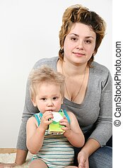 mother and child, who drinks juice