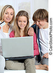 Mother and children at home doing online shopping