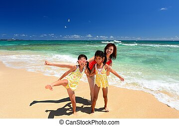 Mother and children at the beach