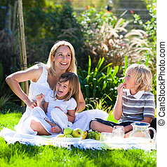 Mother and children having a picnic