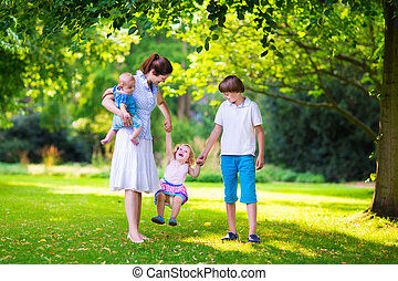Mother and children in a park