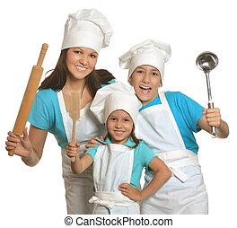 Mother and children in chefs uniform