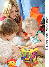 mother and children in playroom