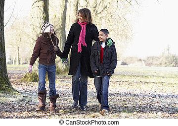 Mother And Children On Autumn Walk