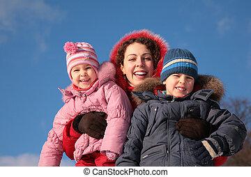mother and children outdoor in winter