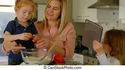 Mother and children preparing food in kitchen 4k