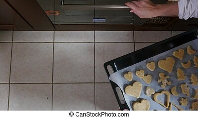Mother and daughter are preparing gingerbread for Christmas