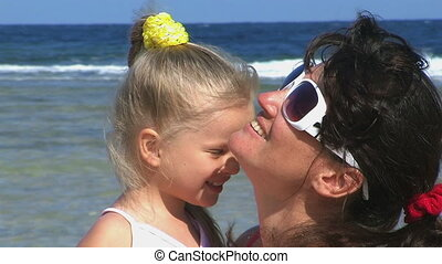 Mother and daughter at beach.