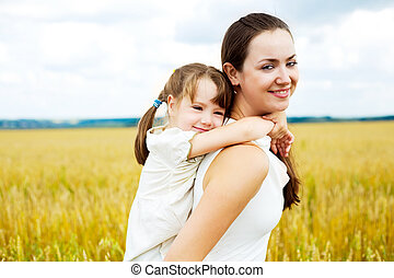 mother and daughter - beautiful young mother and her...