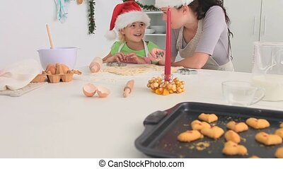 Mother and daughter cooking togethe
